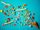 Halloween or Christmas candy - sweet food concept on blue