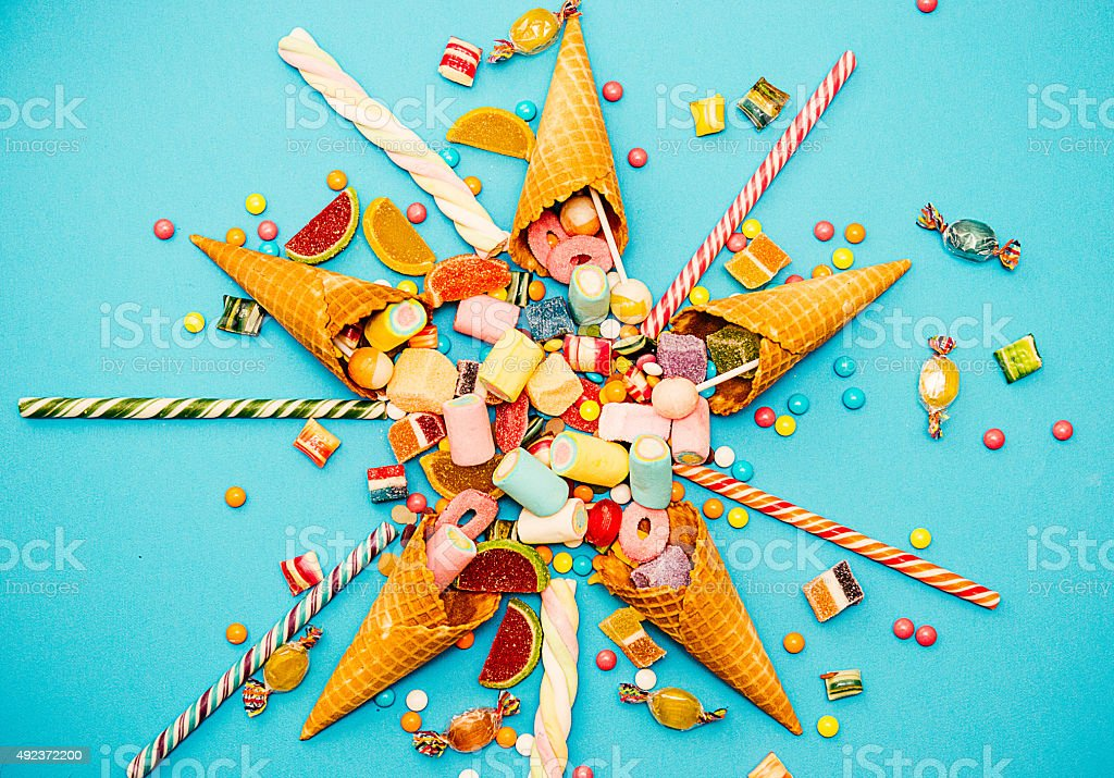 Halloween or Christmas candy, vintage sweet food concept on blue stock photo