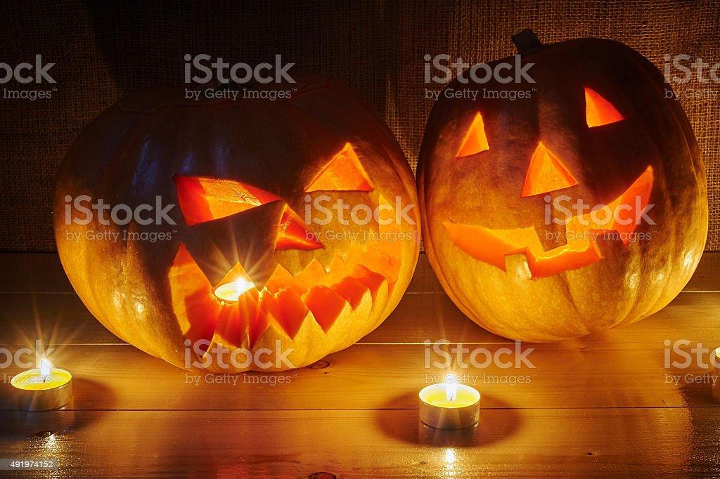 Halloween orange pumpkins jack lantern with candles on a wooden stock photo