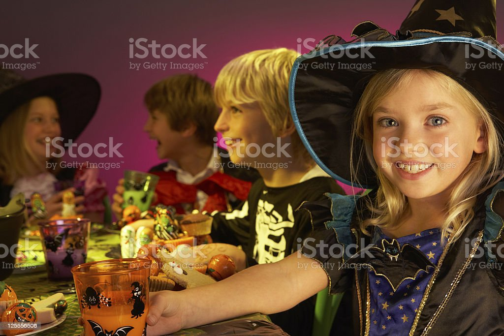 Halloween party with children having fun in costumes royalty-free stock photo