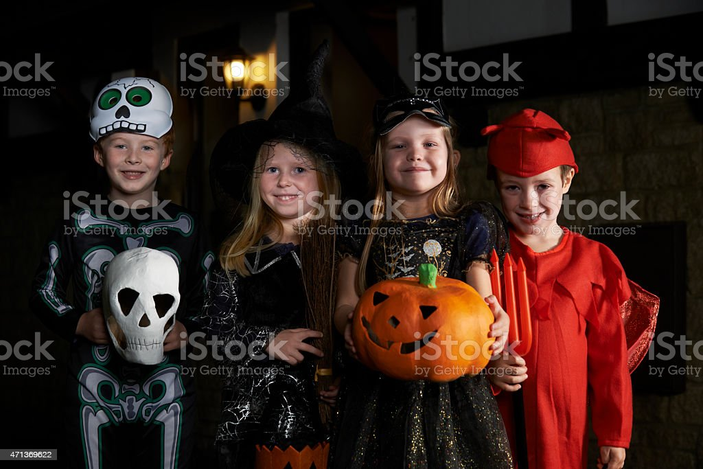 Halloween Party With Children Trick Or Treating In Costume stock photo