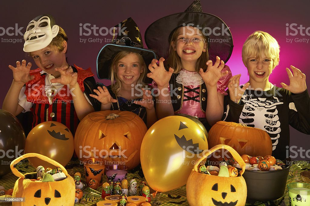 Halloween party with children wearing fancy dress costumes royalty-free stock photo