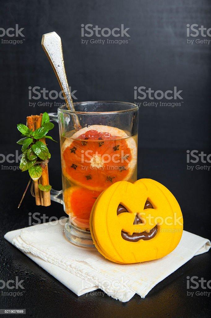 halloween pumpkin cookies & hot drink with red orange, stock photo