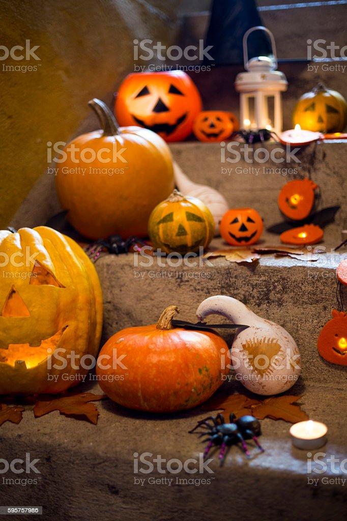 Halloween pumpkin decoration on stone stairs stock photo