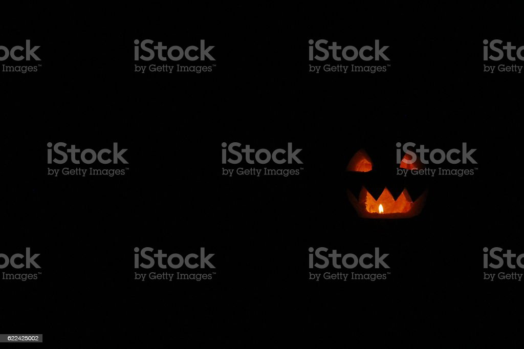 Halloween pumpkin ghost with tongues of flame stock photo