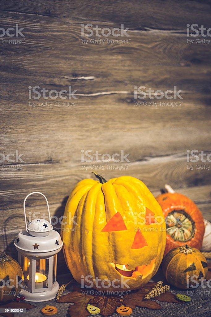 Halloween pumpkin head jack lantern on wooden background stock photo