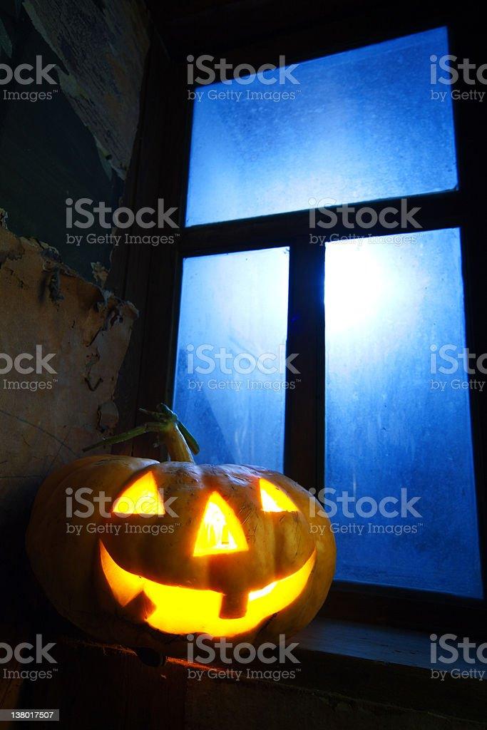 halloween pumpkin in night on old wood room royalty-free stock photo