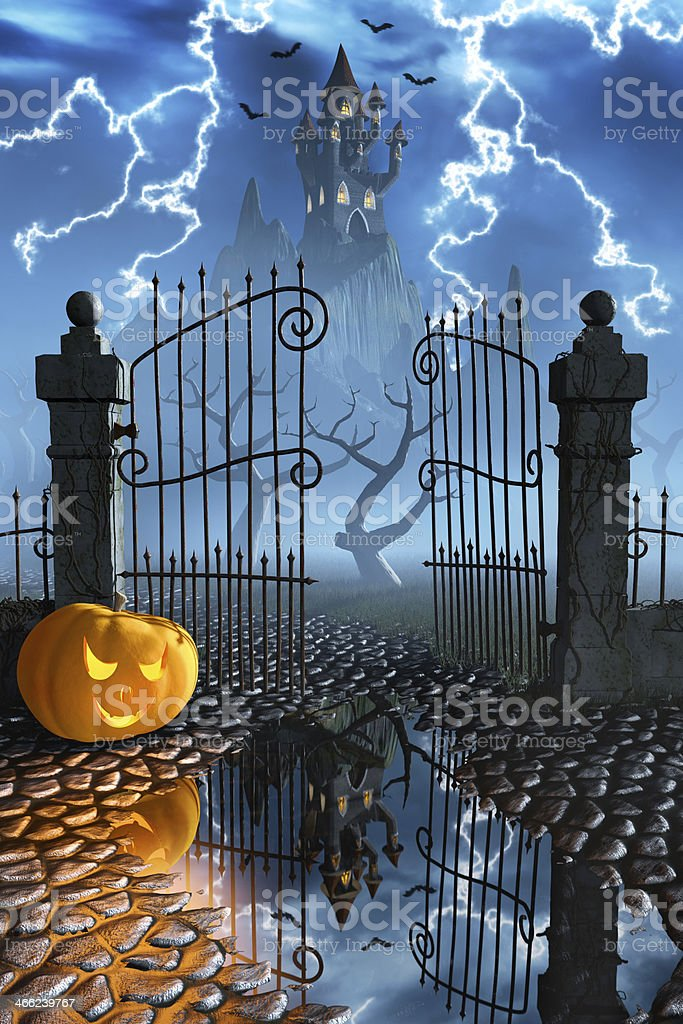 Halloween pumpkin next to a gate of a spooky castle royalty-free stock photo