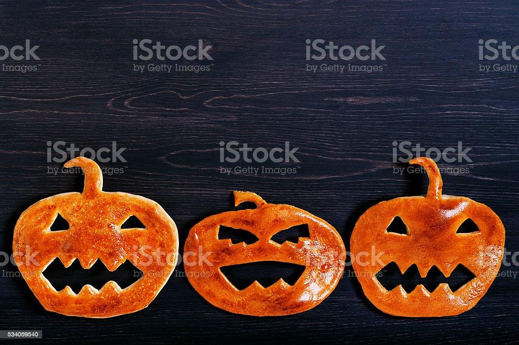 Halloween pumpkin of dough on the wooden table stock photo