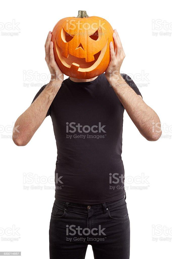 Halloween pumpkin on man head, joking stock photo