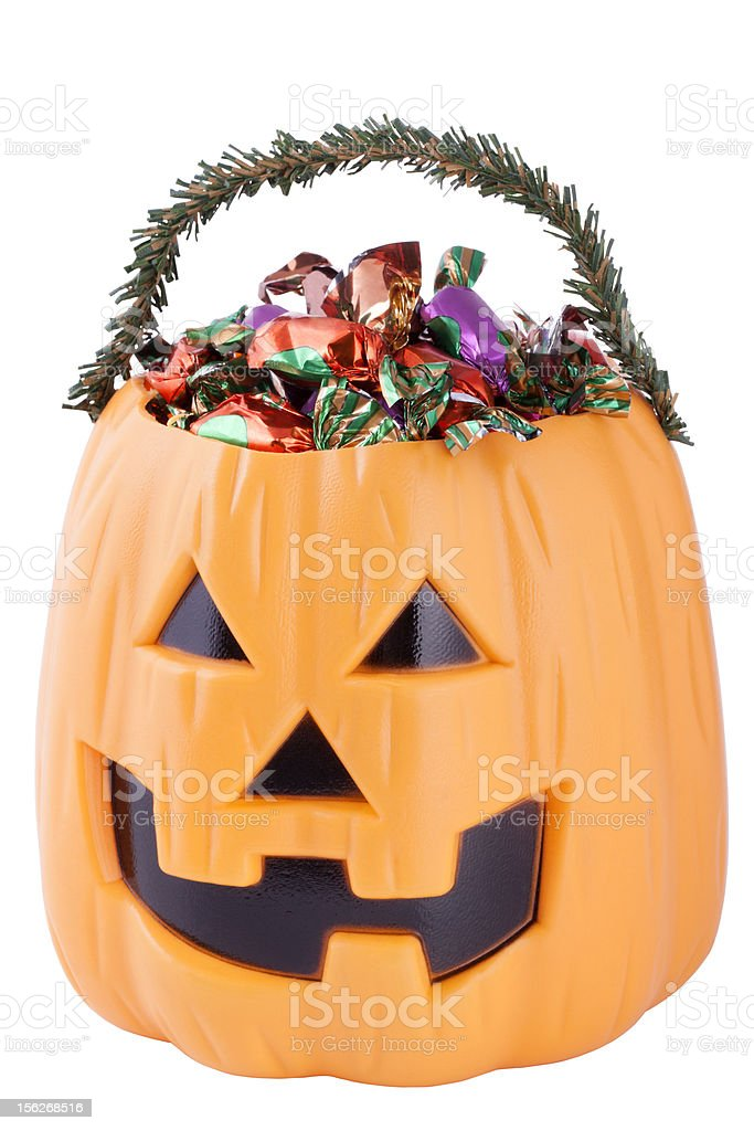 Halloween pumpkin with candies royalty-free stock photo