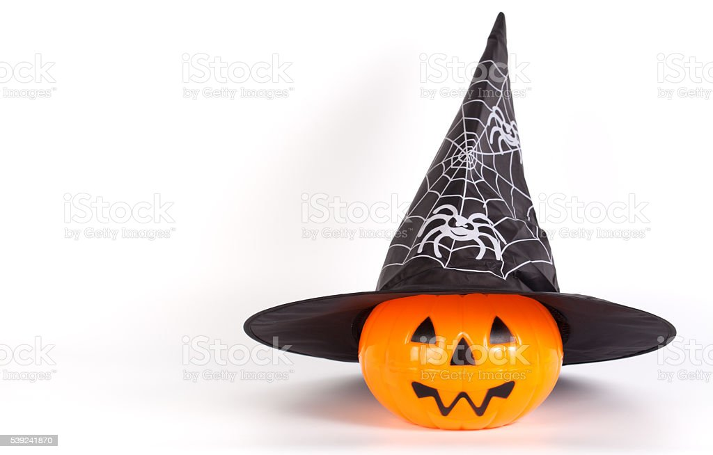 Halloween Pumpkin with Halloween hat with printed white spider stock photo