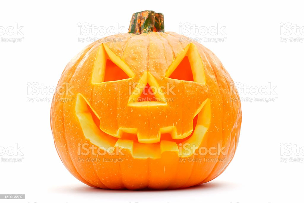 A Halloween pumpkin with its face carved out stock photo