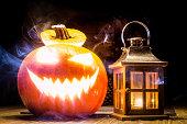 Halloween pumpkin with lantern and mystic smoke