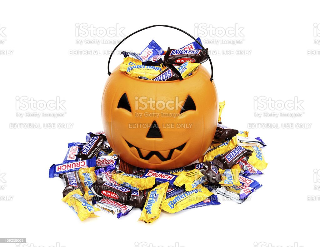 Halloween pumpkin with trick or treat candy stock photo