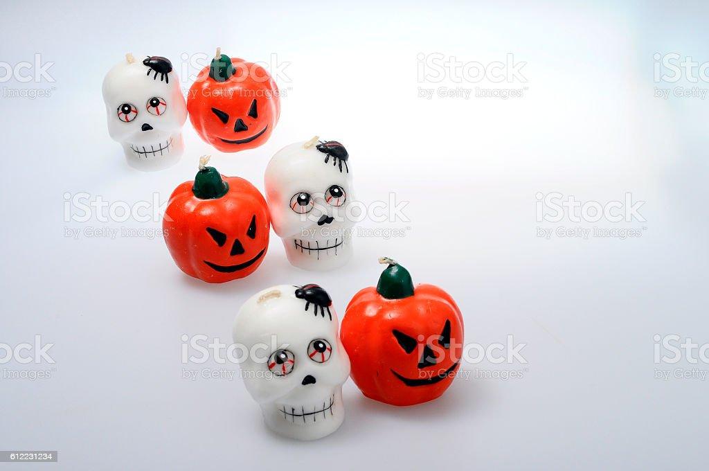 Halloween pumpkins and skulls stock photo