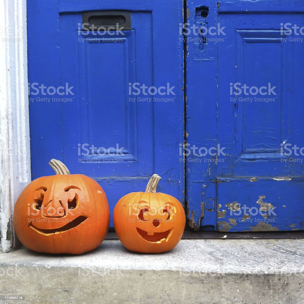 Halloween pumpkins at the door royalty-free stock photo