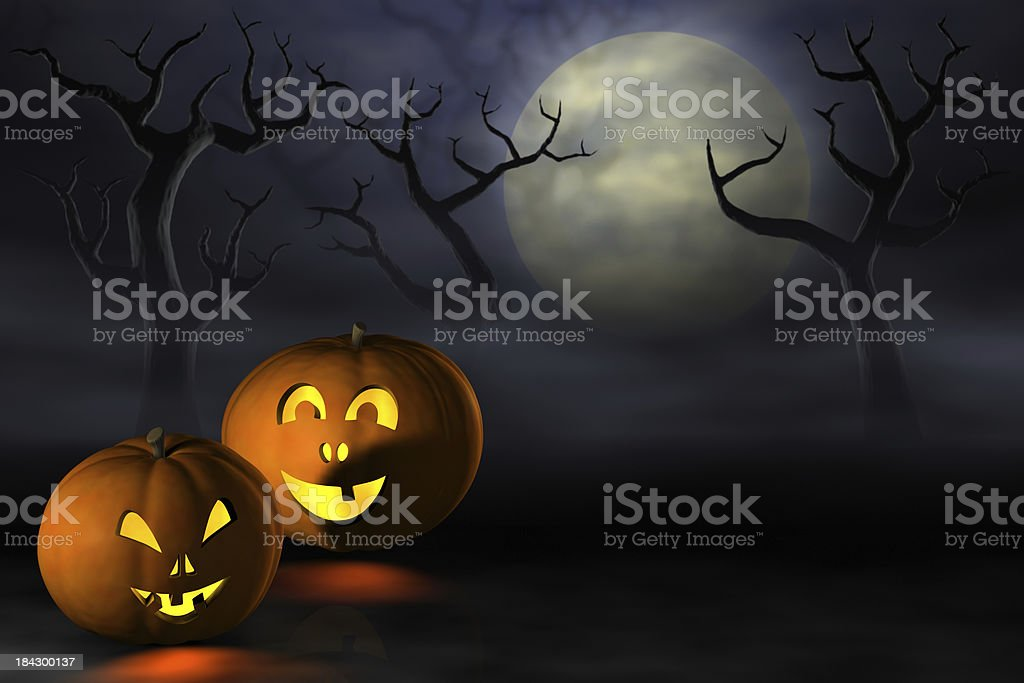 Halloween pumpkins in a spooky forest at night royalty-free stock photo