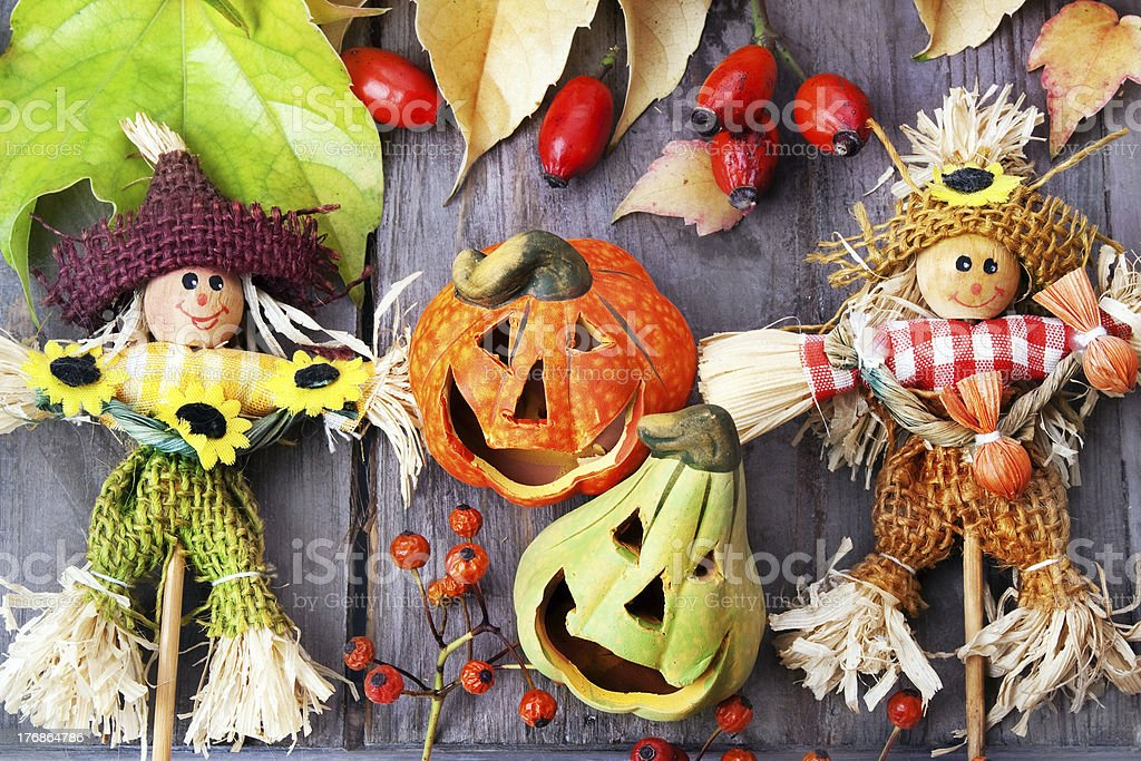 Halloween pumpkins with scarecrows , still life. royalty-free stock photo