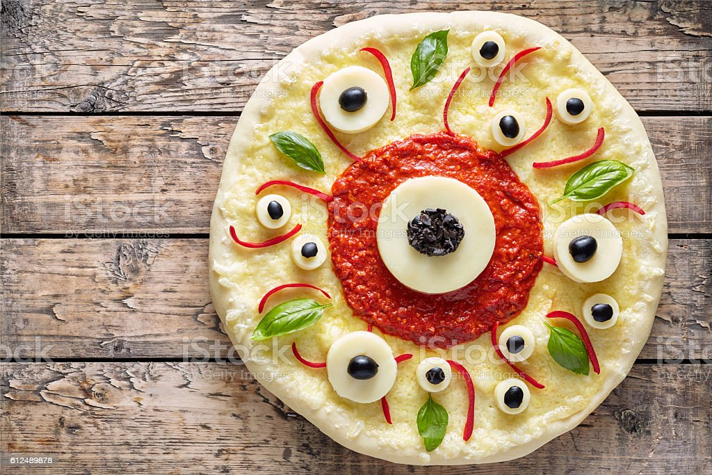 Halloween scary food funny eye monster pizza margherita with mozzarella stock photo