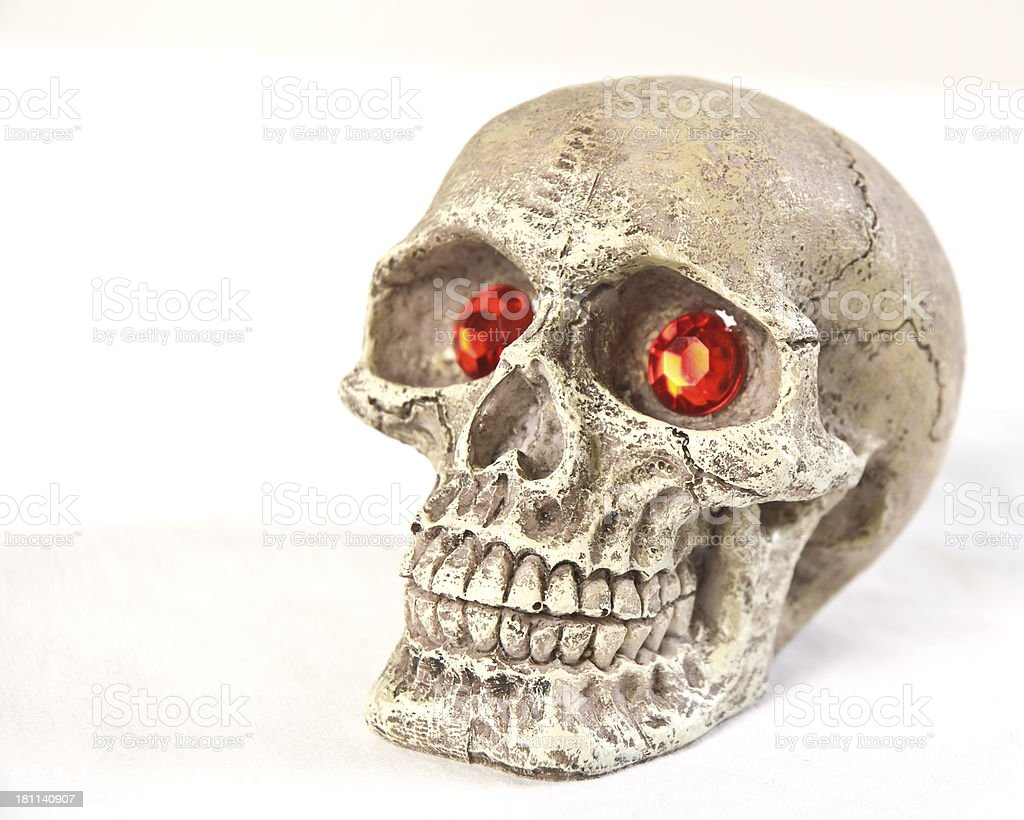 Halloween Scary Human Scull With Red Ruby Eyes stock photo