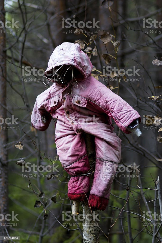 Halloween scary scarecrow in autumn forest royalty-free stock photo
