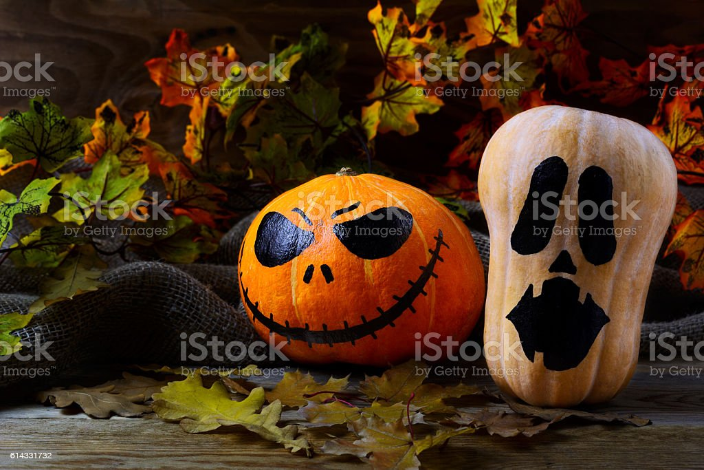 Halloween Stingy Jack pumpkins on dark rustic background stock photo