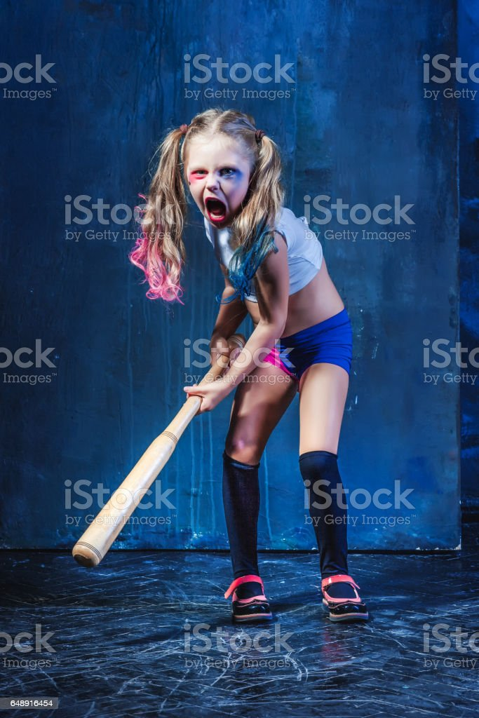 Halloween theme: Girl with baseball bat ready to hit stock photo
