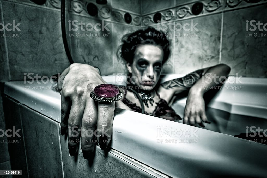 Halloween theme.Scary girl in bath. stock photo