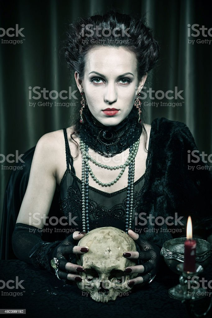 Halloween theme.Witch with a skull stock photo