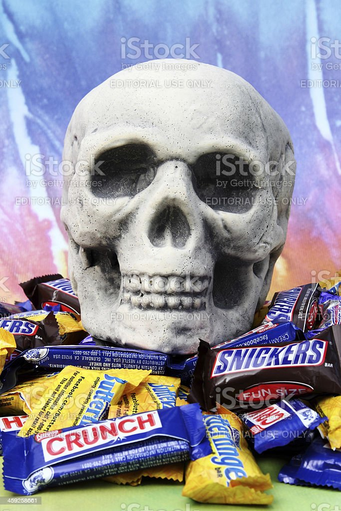 Halloween toy skull with candy closeup vertical stock photo