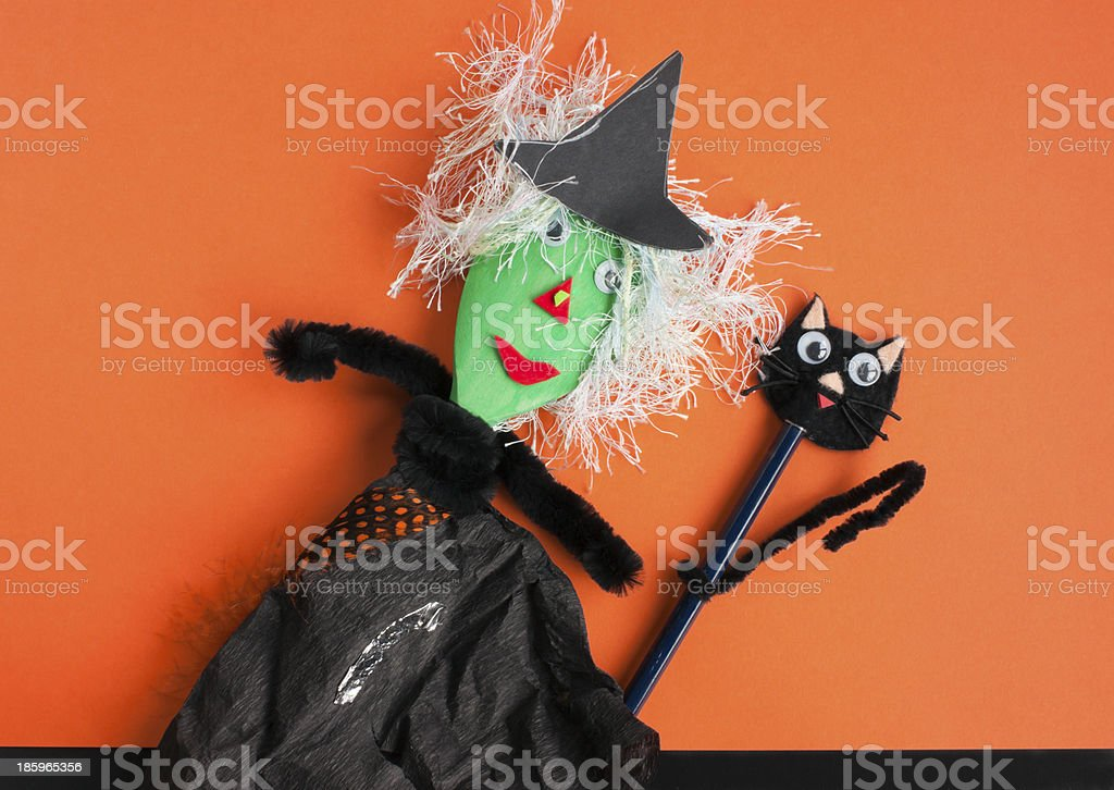 Halloween toys, witch and black cat on orange stock photo