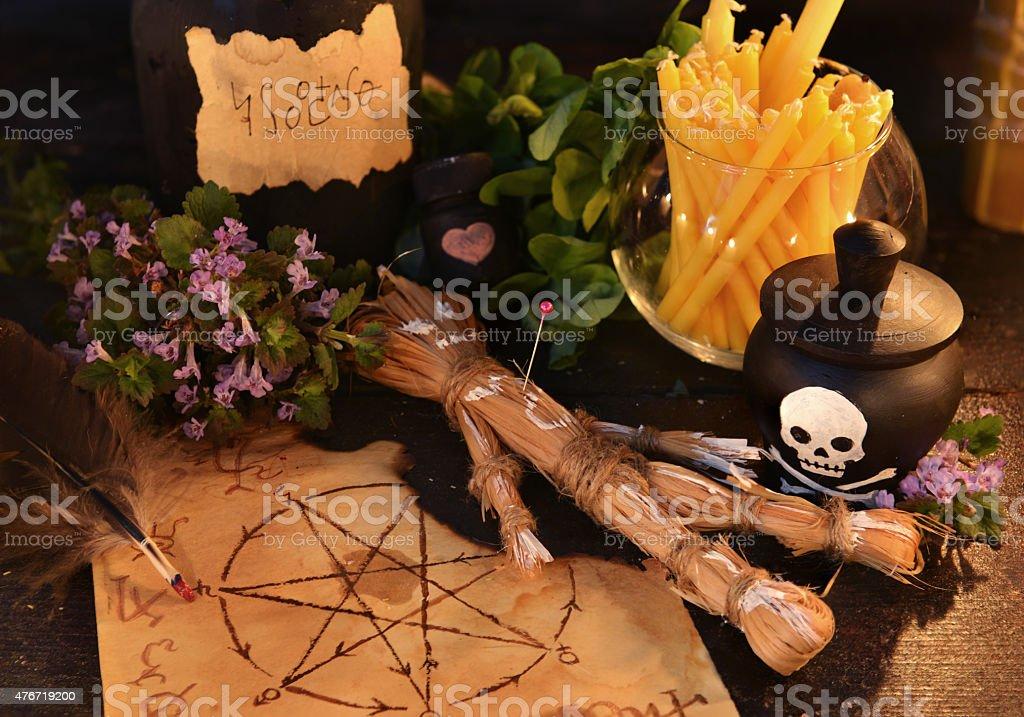 Halloween voodoo theme with handmade straw doll stock photo