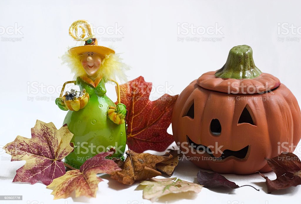 halloween witch and pumpkin with maple leaves royalty-free stock photo