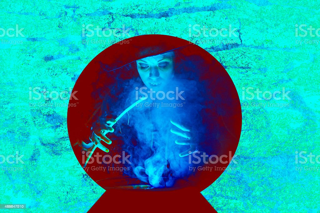 Halloween:  Witch cooking her brew for special guests. Crystal ball. stock photo