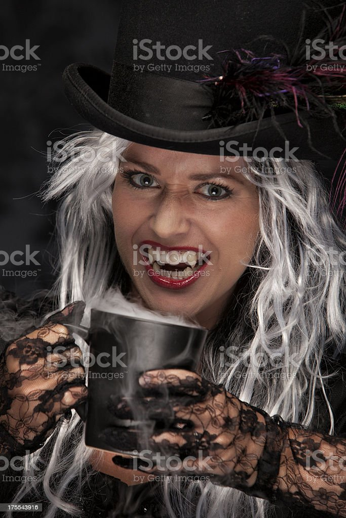 Halloween Witch Drinking Coffee stock photo