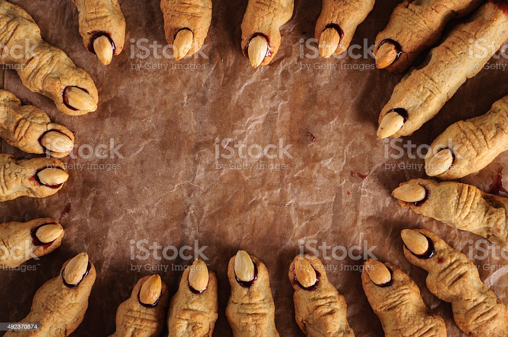 Halloween witch finger cookies with copy space stock photo