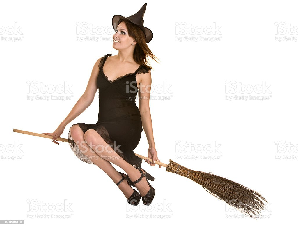 Halloween witch in black dress and hat fly broom. stock photo