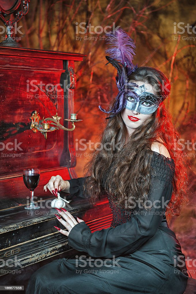 Halloween witch in the mask royalty-free stock photo