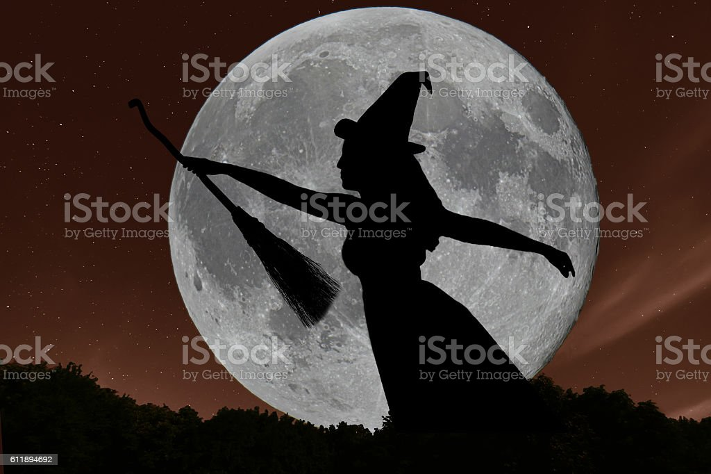 Halloween witch silhouette flying with broomstick. Full Moon. stock photo