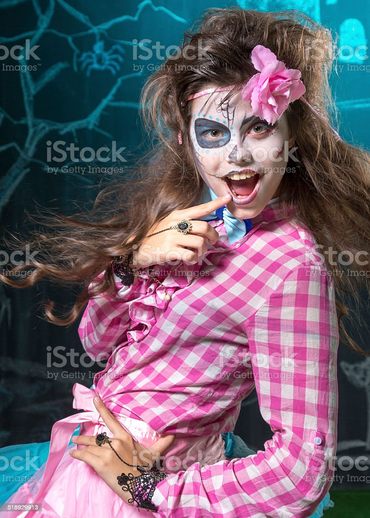 Halloween witch wears bright pink stock photo