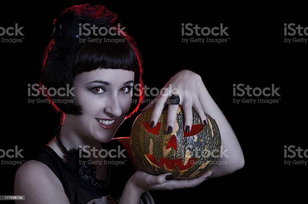 Halloween witch with a pumpkin royalty-free stock photo