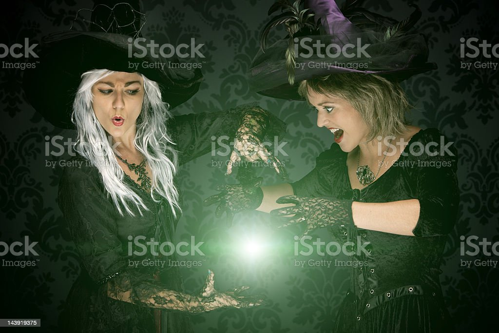 Halloween Witches Conjuring A Spell stock photo