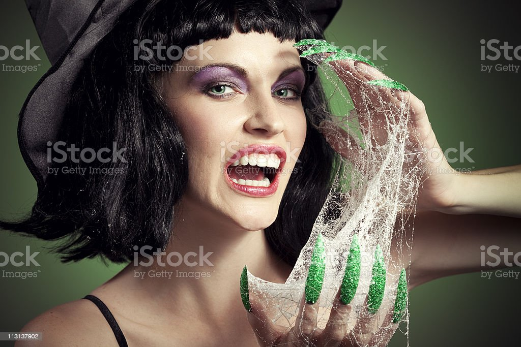 Halloween Woman Face Witch with her green nails stock photo
