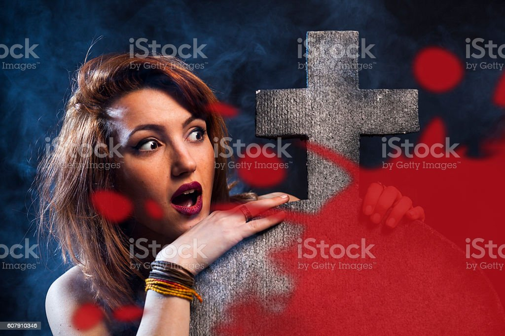 Halloween / Young women in the graveyard stock photo