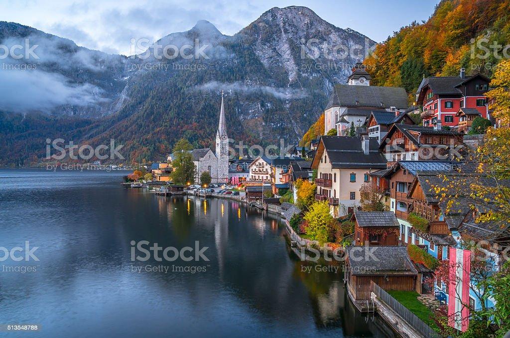Hallstatt mountain village in twilight in fall, Salzkammergut, Austria stock photo