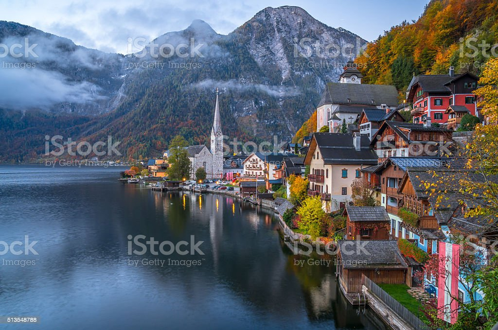 Hallstatt mountain village in twilight in fall, Salzkammergut, Austria stock photo