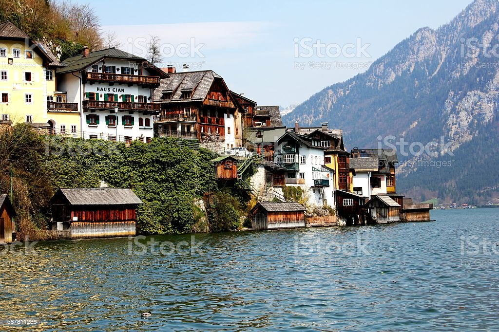 Hallstatt traditional wooden house across the lake stock photo