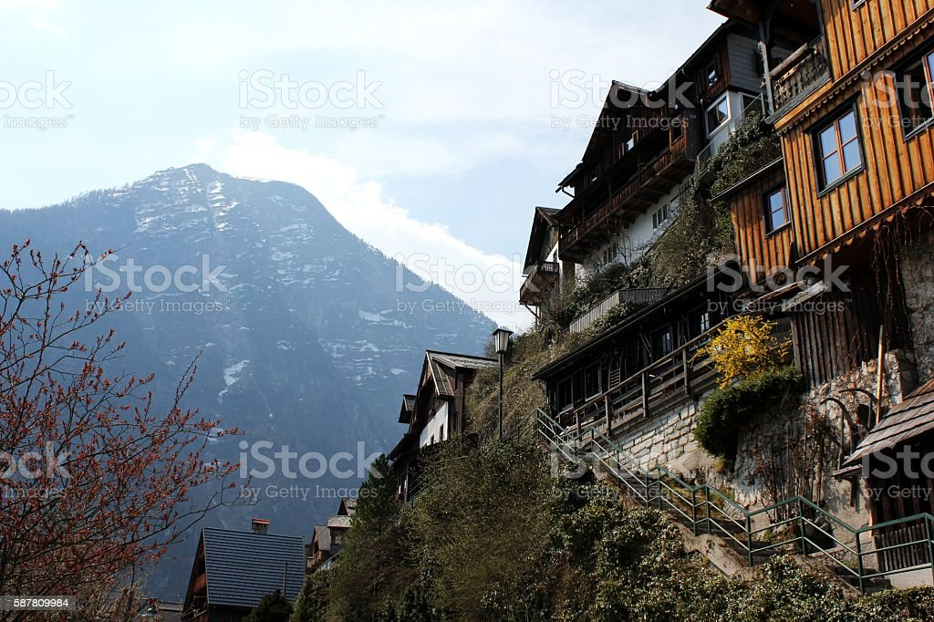 Hallstatt Traditional Wooden House & Clouds over the mountain stock photo