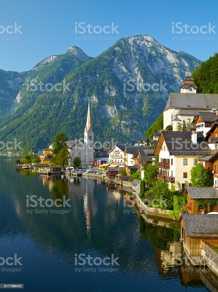 Hallstatt village and alpine lake in morning lights stock photo